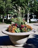 Fall Planter. This is a Fall picture of a cement planter with Fall Seasonal plants on display at the entrance of Millennium Park located in Chicago, Illinois in royalty free stock image
