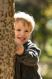 Fall playing hide and seek toddler Royalty Free Stock Image