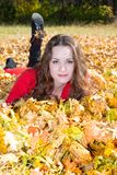 Fall. Portrait of beautiful young woman in autumn park with leaves. Fall. Portrait of beautiful young woman in autumn park with maple leaves royalty free stock image