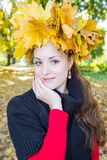 Fall. Portrait of beautiful young woman in autumn park. With maple leaves stock images