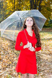 Fall. Portrait of beautiful young woman in autumn park. With maple leaves royalty free stock images