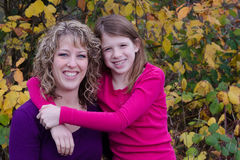 Fall Portrait. Of a mother and her pre-teen daughter with room on the side left for text Royalty Free Stock Photo