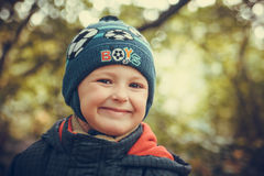 Fall portrait of a smiling boy. Portrait of a smiling boy on a background of autumn trees stock images