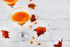 Fall pumpkin martini cocktail on white background royalty free stock photography