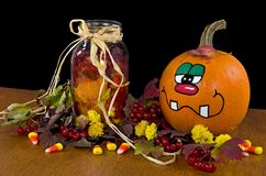 Fall pumpkin with mason jar Stock Photo