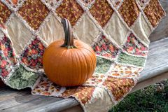 Fall Pumpkin and quilt, a beautiful autumn still life royalty free stock images