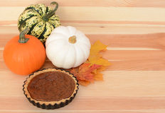 Fall pumpkins and leaves with pumpkin pie Stock Images