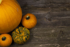 Fall pumpkins. With  and rustic background Stock Photos