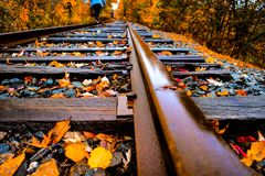 Fall Railroad. Girl walking along railroad tracks in the fall Stock Photography