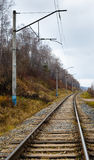 Fall, rails, cross ties, columns, wires Royalty Free Stock Photos