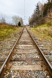 Fall, rails, cross ties, columns, wires Royalty Free Stock Photo