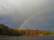 Fall Rainbows. Two rainbows over a small lake Royalty Free Stock Photo