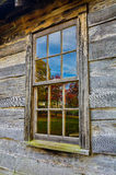 Fall reflections, Brush Mountain Schoolhouse at Cumberlan Gap National Park. Autumn reflections in the window of the old Brush Mountain Schoolhouse in Hensley Royalty Free Stock Photo