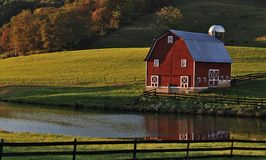Fall Reflections. Class red barn in the fall of 2013 in southern West Virginia, complete with pond reflection Stock Photography