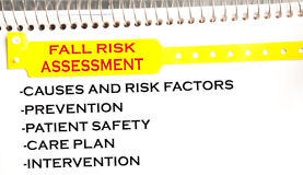 Fall Risk Assessment. Bracelet on a notepad Royalty Free Stock Images