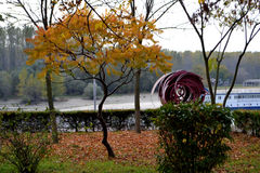 Fall River Borcea. End October Borcea river. Carpets of leaves, colorful trees, autumn sky, boats and pontoons on the banks royalty free stock photos