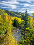 Fall River, Mountains, and Bluy Sky with Clouds Stock Photography