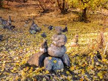 Rock Cairn Piles, Autumn Fall forest views hiking through trees on the Rose Canyon Yellow Fork and Big Rock Trail in Oquirrh Mount Royalty Free Stock Photo