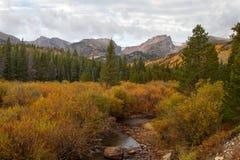 Fall in Rocky Mountain National Park. A river runs through an autumn scene at Rocky Mountain National Park stock photos