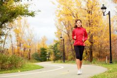 Fall Running - Woman Jogging In Autumn Stock Images