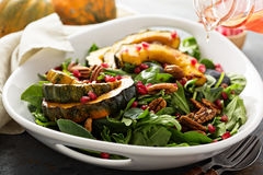 Fall salad with greens and acorn squash Royalty Free Stock Images