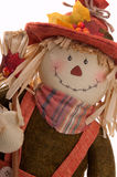 Fall Scarecrow. Fall Decoration Of A Stuffed Decorative Scarecrow For Thanksgiving Celebrations, Cut-Out On A White Background