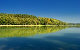 Fall Scene and Trees Autumn Reflection on Duna river Royalty Free Stock Image