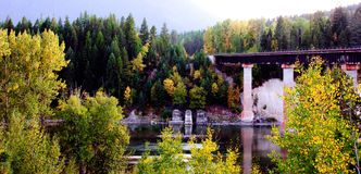 Fall Scene of Rail Bridge over River Royalty Free Stock Photography