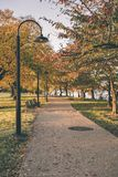 A Walk Path with Lamp Post with Fall Scenery royalty free stock photos