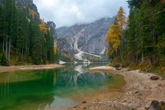 Fall scenery of lake Braies, Dolomite Alps, Italy. Fall scenery of lake Braies - lago di Braies at Alps background in South Tyrol in Italy. European famous and Stock Images