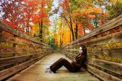 Fall season. Pretty girl posing on the bridge during fall season Stock Images