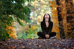 Fall season. Pretty girl posing on top of a smal hill during fall season royalty free stock image