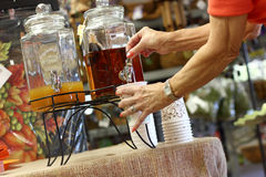 Fall Season Apple Cider. A senior woman pours herself a cup of delicious apple cider to kick off the Fall season Stock Image