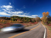 Fall season with moving car Stock Images
