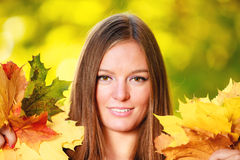 Fall season. Portrait girl woman holding autumnal leaves in park Royalty Free Stock Photo