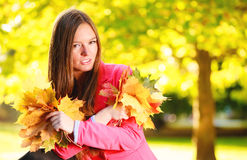 Fall season. Portrait girl woman holding autumnal leaves in park Stock Photography