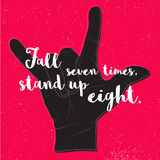 Fall Seven times, Stand up Eight. Quote on Black Devil Hand Symb Royalty Free Stock Photos