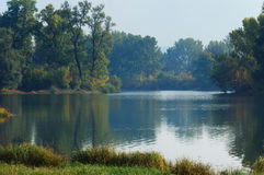 Fall silence. Peaceful autumn day by the river in countryside Stock Photos