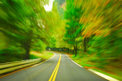 Fall speed. Speeding down a fall road Royalty Free Stock Photography