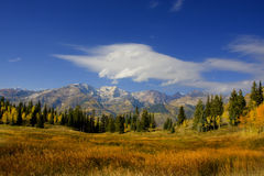 Fall Splender. High Mountain Flat in the fall showing all the fall colors with mountains in the background stock images