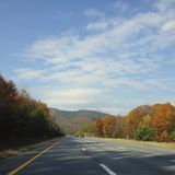 Fall on the road Stock Photography