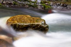 Fall and stone. Waterfall stream and big stone Stock Photography