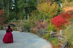Fall at Stone Mountain Georgia. A woman in full Victorian costume enjoys fall at Stone Mountain Park in Georgia Stock Image