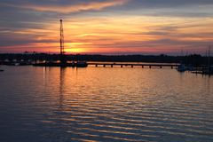 Fall Sunset in New Bern North Carolina. Fall Sunset in New Bern, North Carolina over the water from the Cunningham Bridge stock photography
