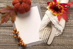 Fall Table Setting with Blank Invite or Menu Card with space or room for your copy, text or design. A horizontal photo with fork, royalty free stock photo