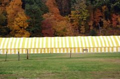 Fall Tent Festival. Big long yellow striped tent at fall tent festival Stock Photography