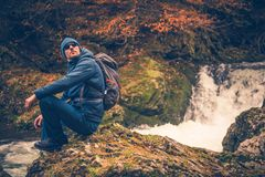 Fall Time Hiking. Autumn Foliage and the Hiker Resting on the River Creek Boulder stock images