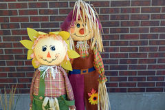 Fall time Scarecrows. Display of boy & girl scarecrows Stock Photography