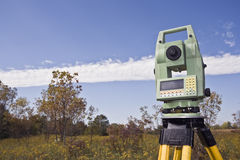 Fall time surveying. Fall time land surveying - total station set in the field stock photography