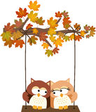 Fall tree with owls swinging Royalty Free Stock Photography